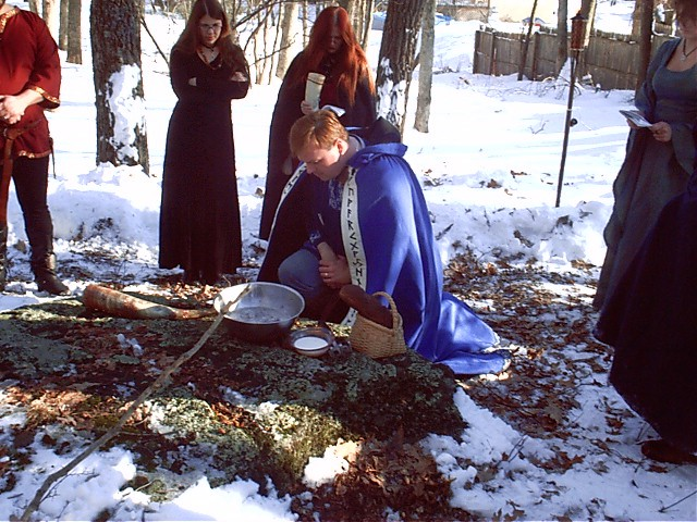 In a photograph from New Normandy's website, Dan Halloran leads a heathen ritual.