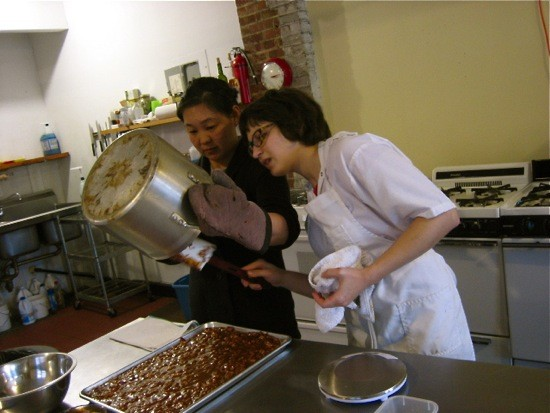 Jen King (left) and Liz Gutman tackle a batch of caramel.