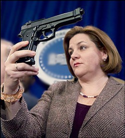 Trigger-unhappy council chief Christine Quinn demonstrates the wrong way to shoot your spouse.