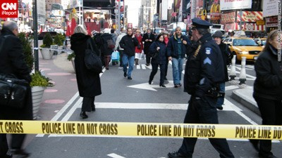 Shopping spree: Shoppers ducked for cover as bullets flew between a vendor and cops in Times Square yesterday.