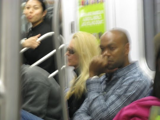 Ann Coulter, riding the subway. Click to enlarge.