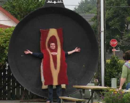 Impersonating a strip of bacon in the World's Largest Frying Pan, Long Beach, Washington.