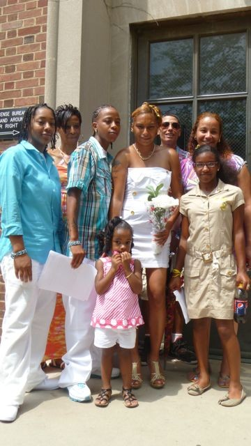 Desiree Bussell (in blue plaid) and Katrice Shelton (holding flowers) wed at Queens Borough Hall on Sunday.