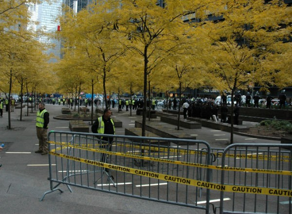 Zuccotti Park this morning, with police inside and protesters outside.