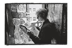 Andy Warhol reading the Village Voice in 1965. Wig looks just fine there.
