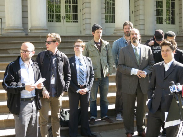 Journalists, protesters, and their lawyers announcing a federal suit against the NYPD this morning.