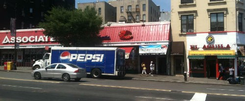 """As we noted in a prior post, under Mike Bloomberg's proposed """"Big Gulp Ban,"""" you could buy all the Pepsi in that truck -- as long as you buy it from the grocery store on the left, and not the Mexican restaurant on the right."""