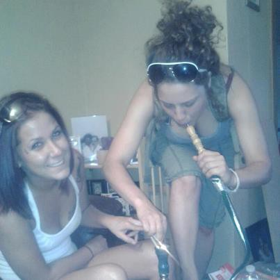 The shit-bag on the left is Megan Merkel. That pipe she's holding is a hookah, which is more often than not used to smoke weed. This photo was posted on Facebook. Smooth move, Merkel.