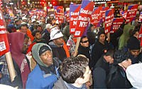 Workers and supporters pack 42nd Street in Times Square.