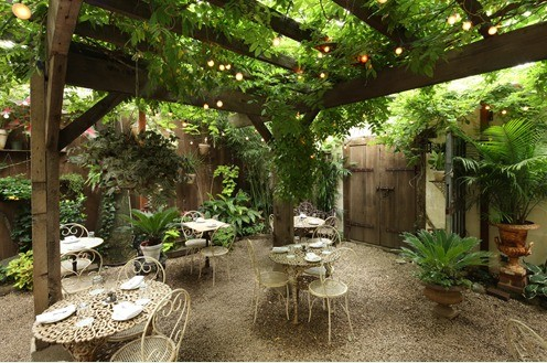 The backyard scene at Maison Premiere is a fun option for those sticking around for Labor Day Weekend