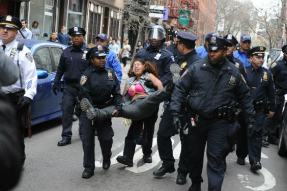 A woman is arrested at an Occupy Wall Street demonstration protesting police brutality.