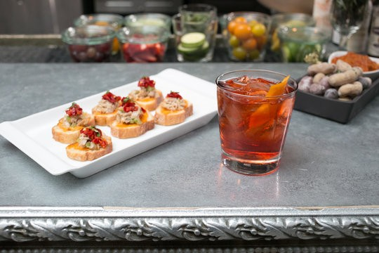 Live the high life for less during happy hour at Isola at the Mondrian SoHo