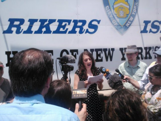 McMillan reads her statement in front of the Rikers entrance.