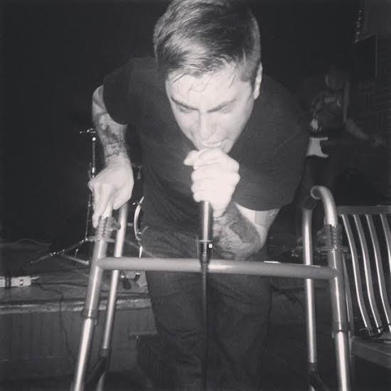 Sean Gray, who uses a walker and sings in the band Birth (Defects), is pissed off about the East Coast's inaccessible music venues.