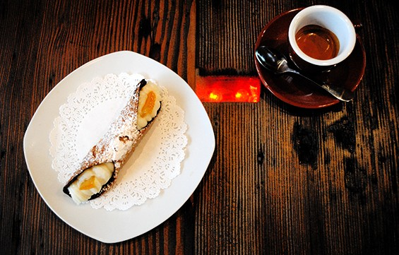 Cannoli flown in from Sicily served on an LED-embedded table at 9 Bar Cafe in Jersey City