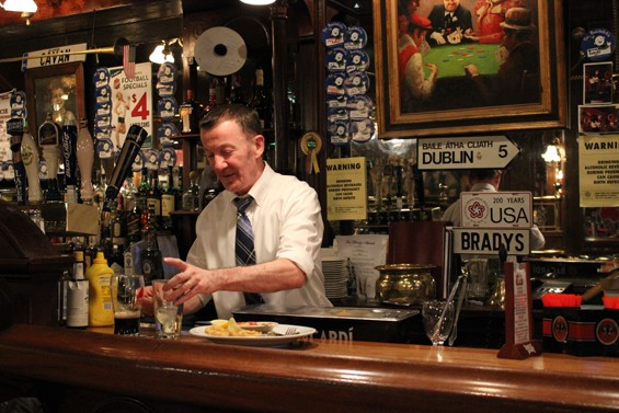 """Joe O'Dea, 54, has been working at Jim Brady's Irish Pub for twenty years. He's """"undecided"""" about the tipped minimum wage increase slated for December 2015."""