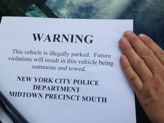 Flyer placed by the NYPD on illegally parked vehicles near the Midtown South precinct