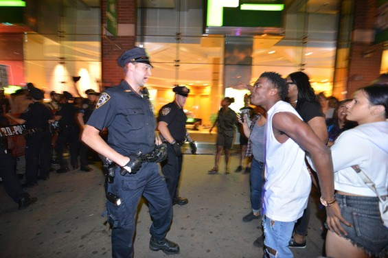 A man confronts a member of the NYPD on August 14 during a protest against police brutality. The author of a new report says he hopes it shows the less scrutinized aspects of broken-windows policing -- not the deaths at the hands of officers -- but the routine, low-level harassment.
