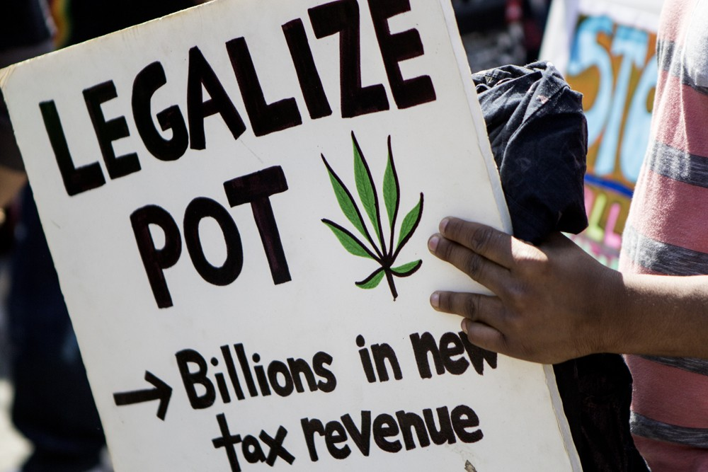 A marijuana advocate holds a sign on May 2, 2015, during the New York City cannabis parade.