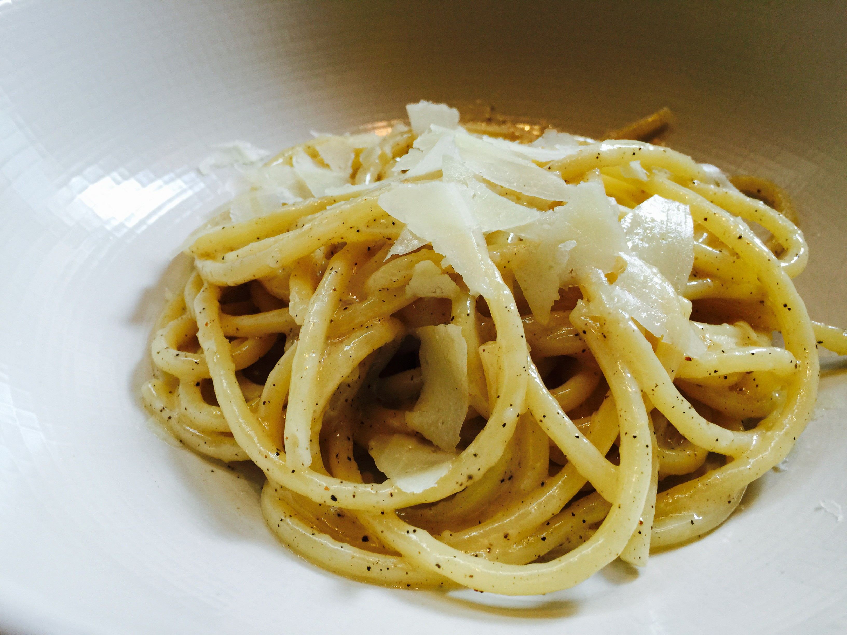 Bucatini bathed in butter, black pepper, and Italian cheese