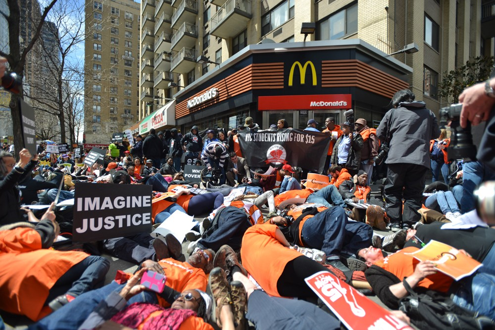 Fast-food workers protest low wages on April 15 outside a Manhattan McDonald's.