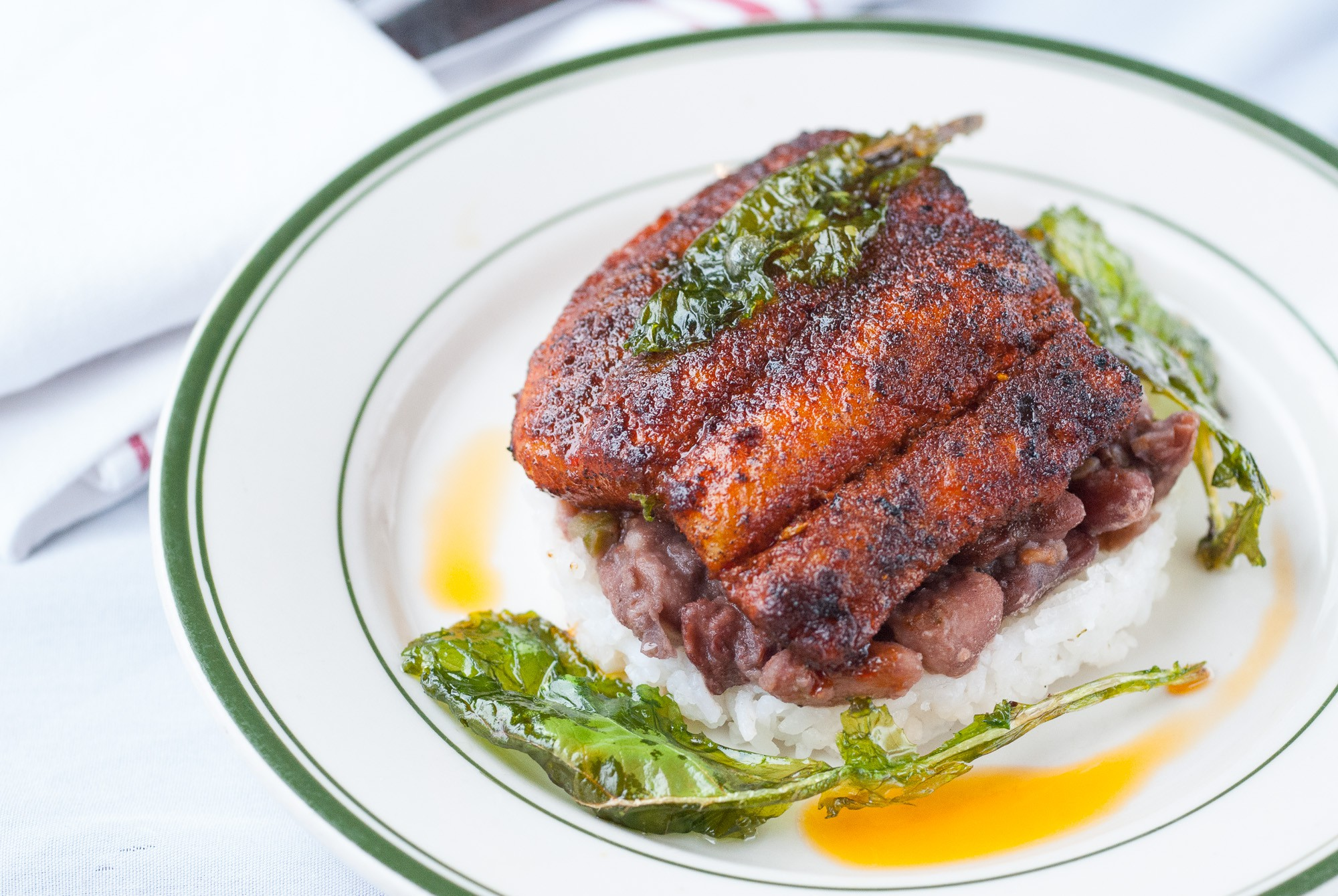 Blackened catfish with Creole cooked red beans and turnip greens, inspired by Edna Lewis