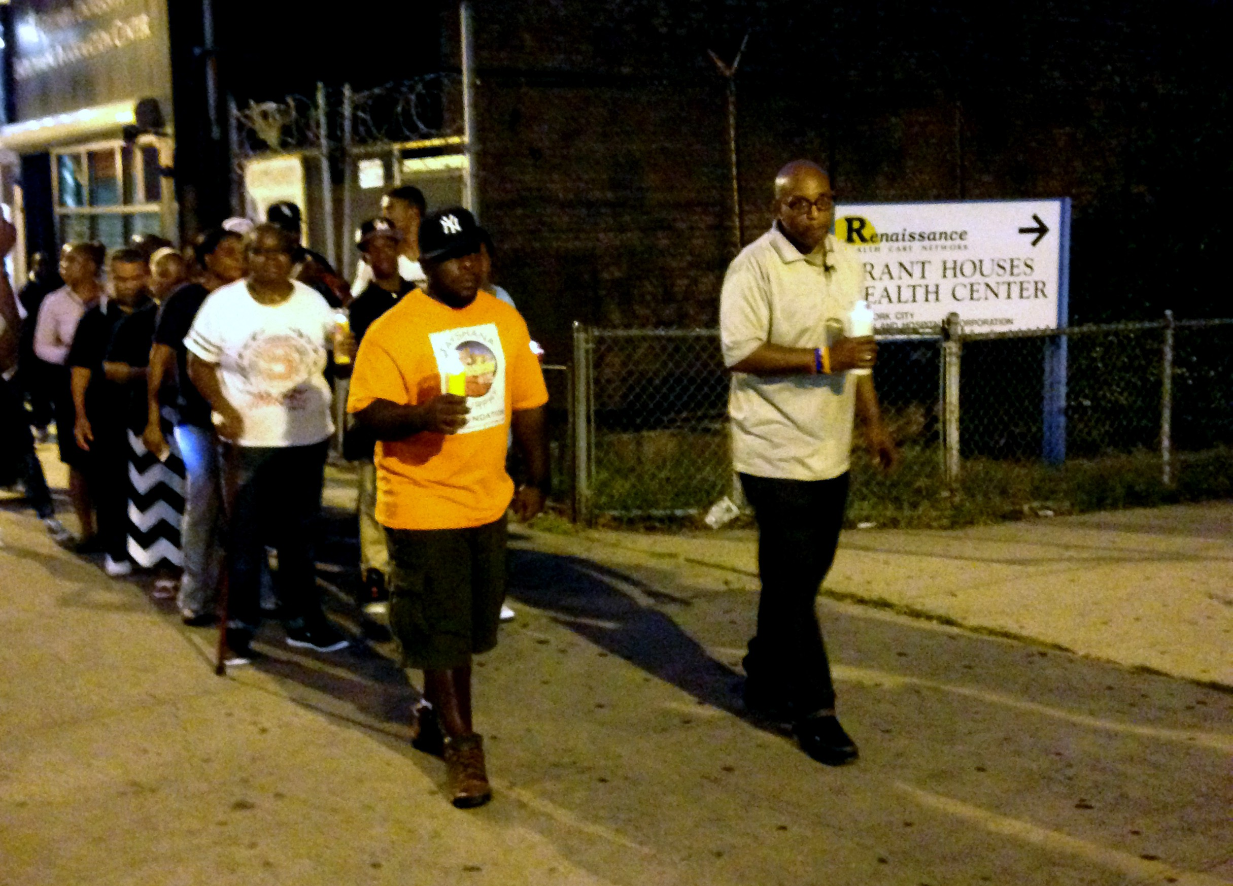 Taylonn Murphy leads a candlelight vigil in West Harlem to commemorate his daughter, Tayshana Murphy, and bring together the community.