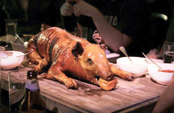 Enjoy a whole roast pig and the music of Dr. John!