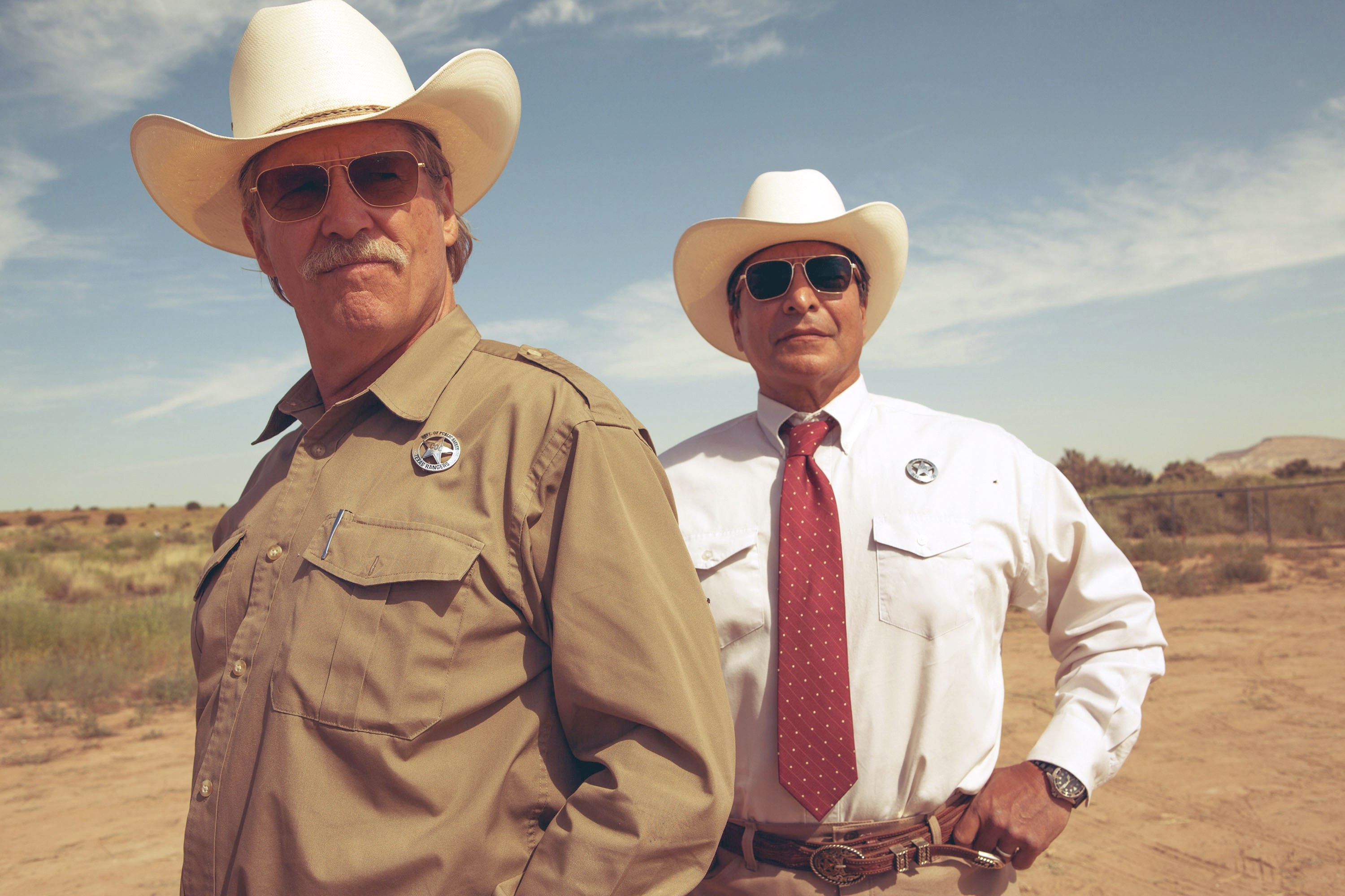 Bridges (left, with Gil Birmingham) as an aging lawman in Hell or High Water