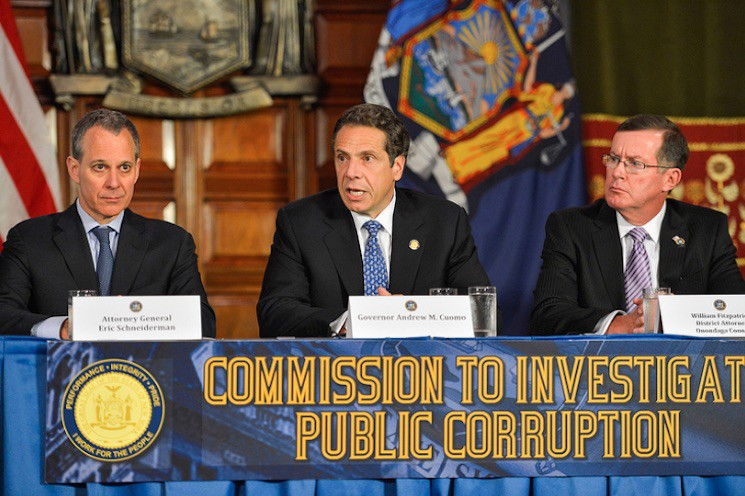Governor Cuomo announces the creation of the Moreland Commission (which he would later disband) next to Attorney General Eric Schneiderman (left).