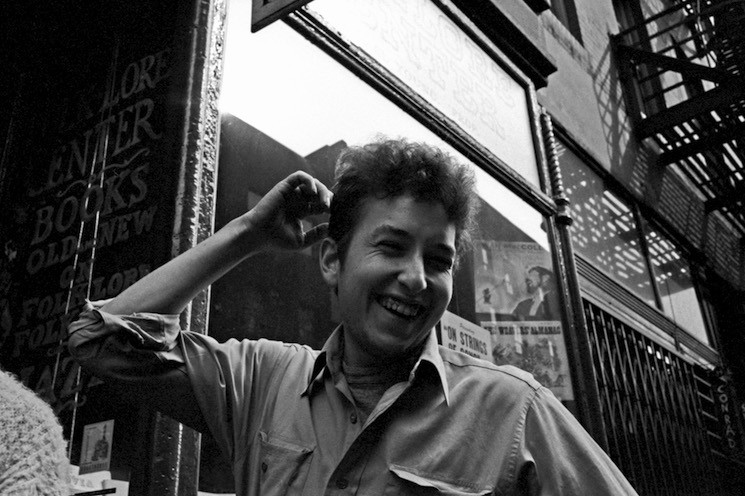 Singer songwriter Bob Dylan poses for a portrait in May 1962 in front of the Folklore Center, the legendary folk music store on MacDougal Street in Greenwich Village.