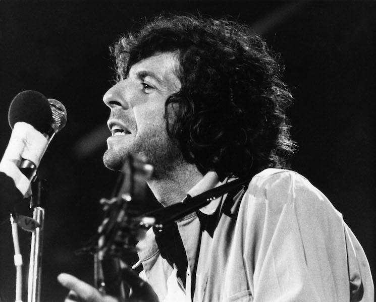 Leonard Cohen performs on stage at the Isle of Wight Festival on August 30 1970.