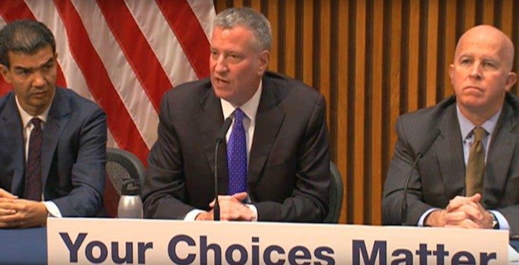 Mayor de Blasio at Tuesday's press conference, flanked by City Council Transportation Committee Chair Ydanis Rodriguez (left) and NYPD Commissioner James O'Neill.