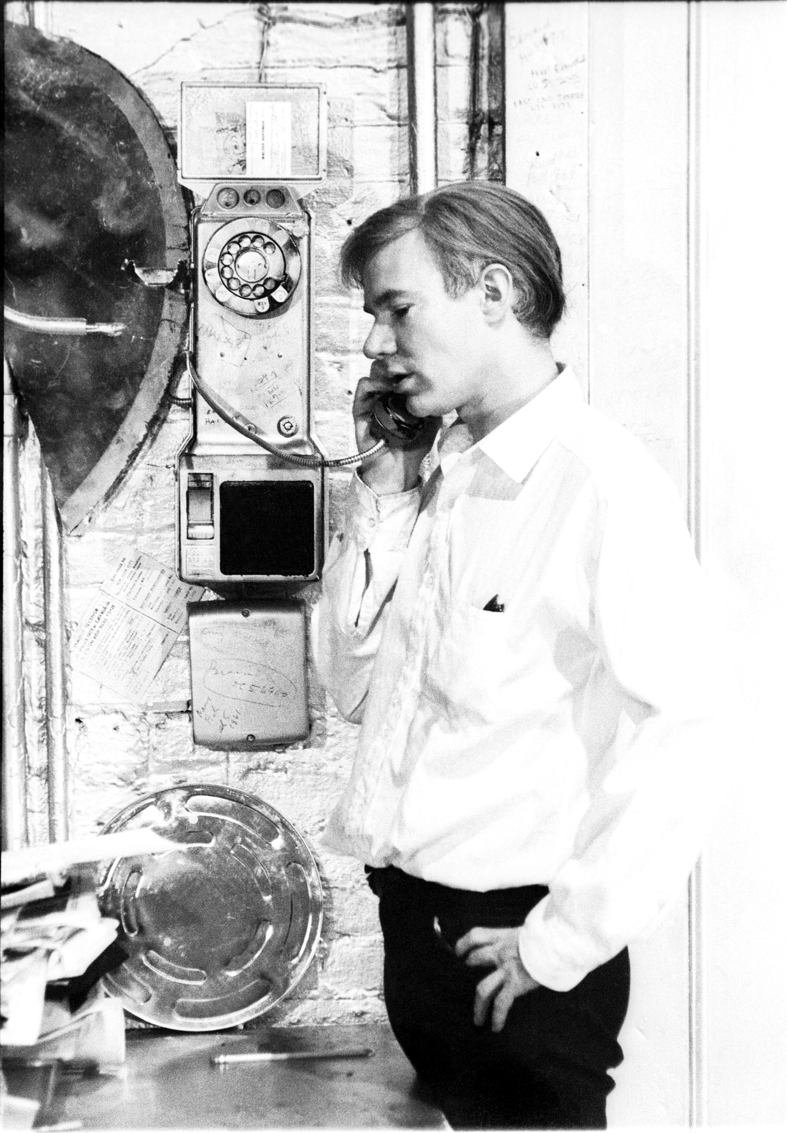 Andy Warhol on payphone at the Factory, 1964