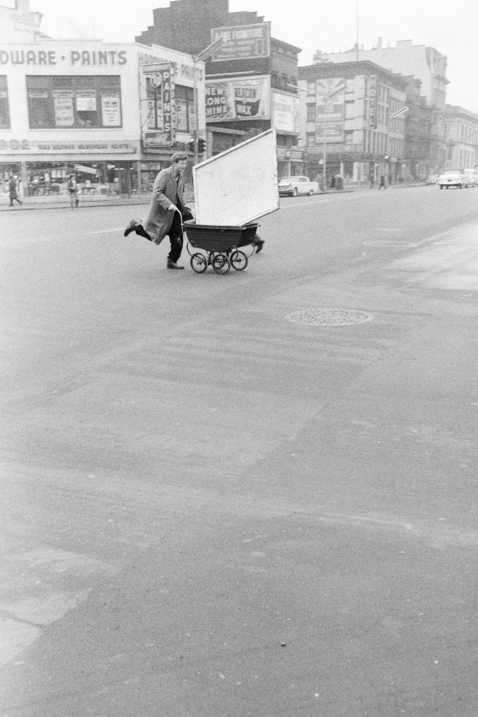Red Grooms transporting artwork across the street to Reuben Gallery, 1960