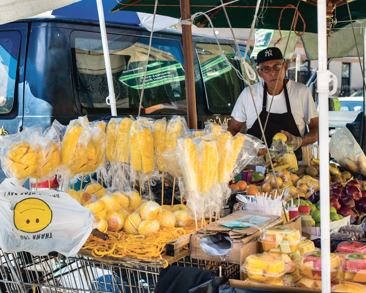 Grab a sliced mango or pineapple stick from one of Broadway's many street vendors.