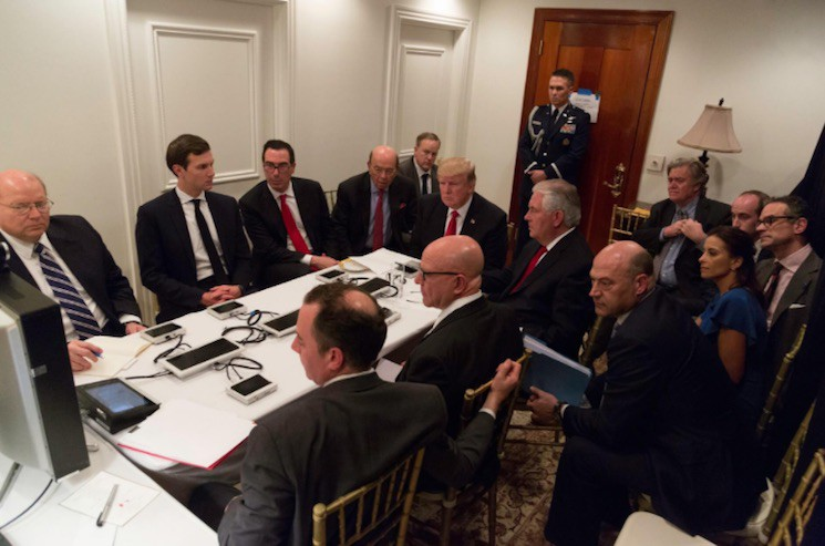 President Donald Trump receives a briefing on a military strike on Syria from his National Security team, including a video teleconference with General James Mattis, secretary of defense, and General Joseph F. Dunford, chairman of the Joint Chiefs of Staff, on April 6 in a secured location at Mar-a-Lago in West Palm Beach, Florida.