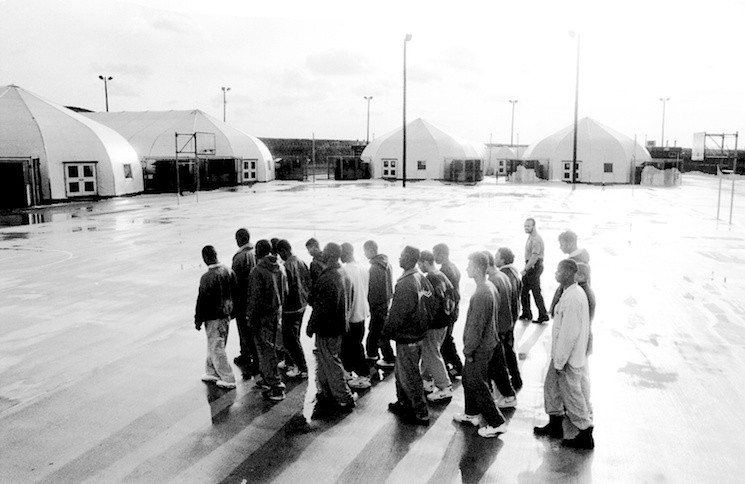 Rikers Island detainees drill in the courtyard of the new Sprungs area, where 16- to 18-year-old detainees live and attend school while awaiting trials and sentencing, on December 4, 1991.