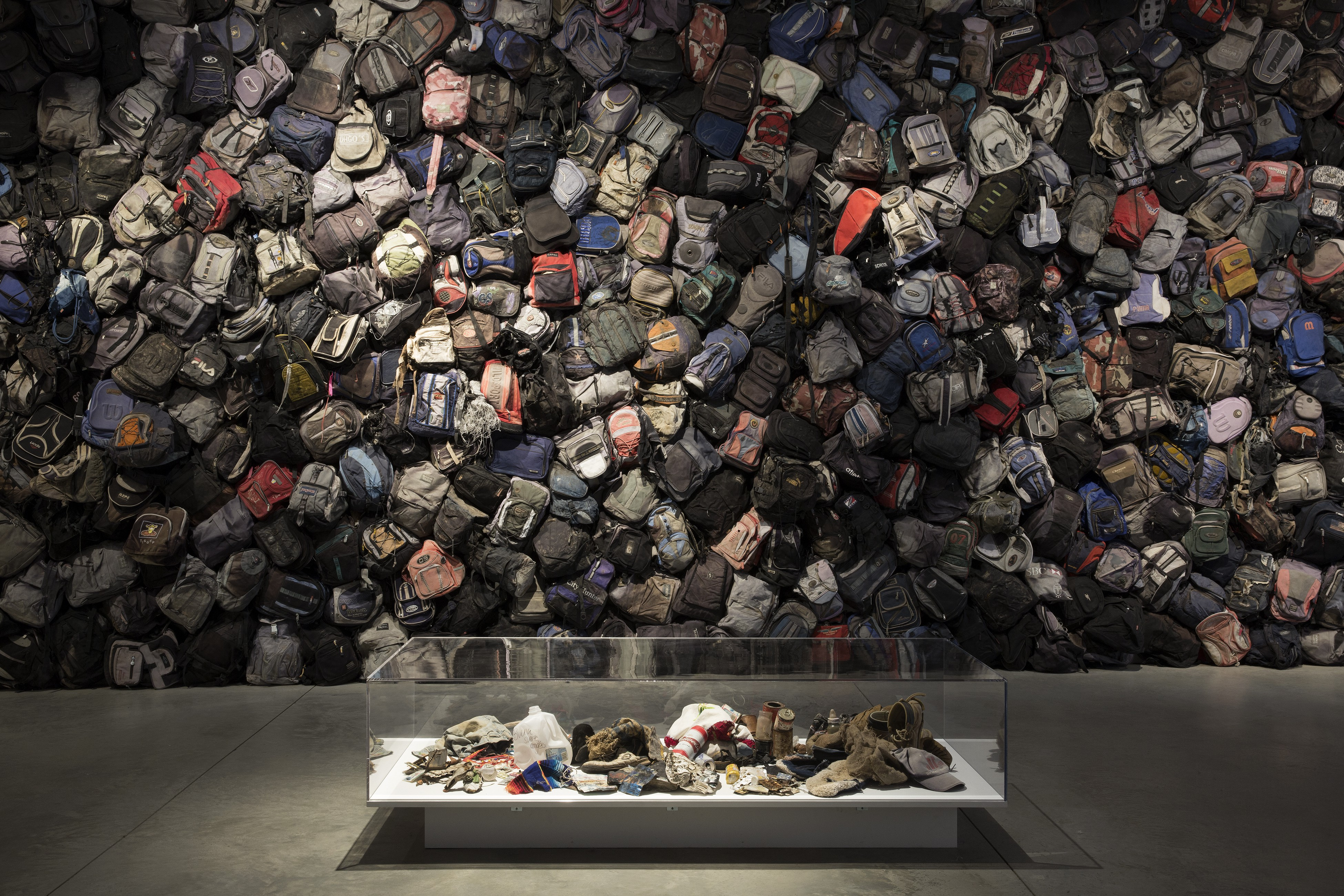 A wall of nearly 800 backpacks left behind at the Mexico-U.S. border.