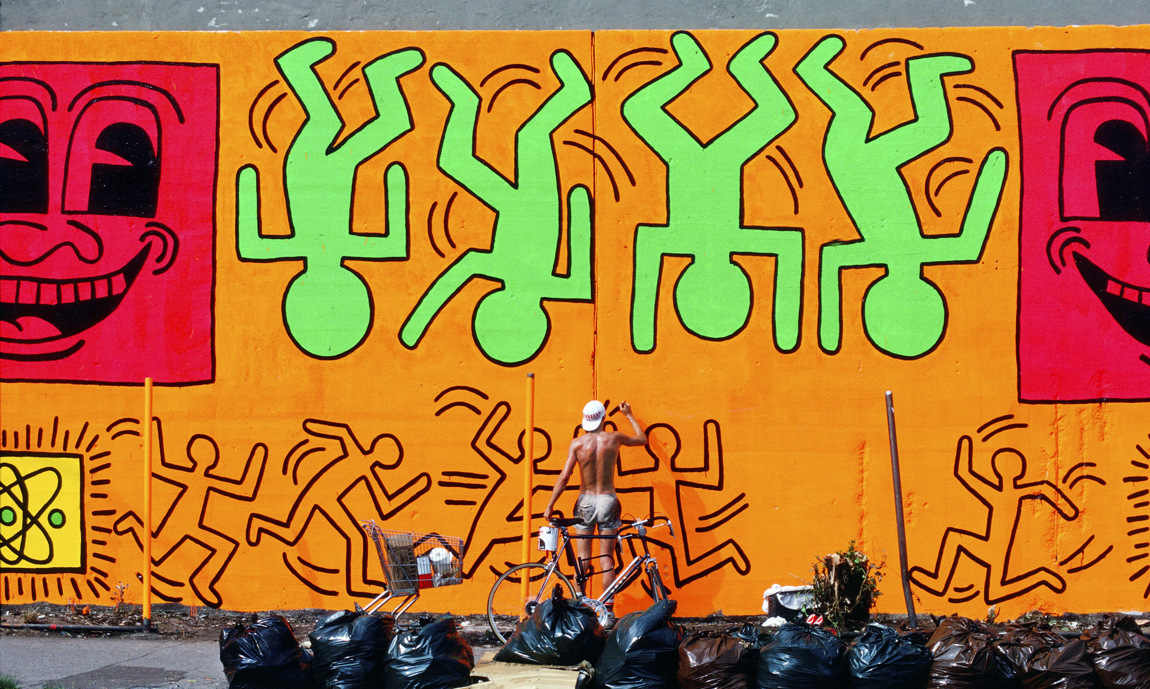 Keith Haring Painting the Houston/ Bowery Wall, Lower East Side, N.Y. (1982).