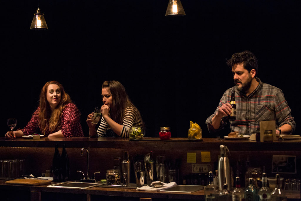 Left to right: Julia Sirna-Frest, Leah Karpel, and Jorge Cordova knock back a few in a hip Brooklyn bar.
